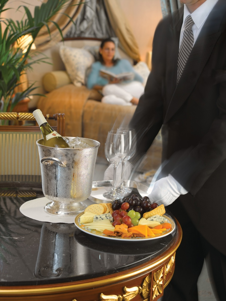 vista-suite_butler-presenting-wine-and-cheese.jpg